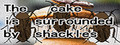 The cake is surrounded by shackles-game